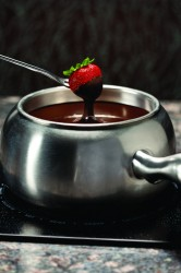 Dipping a Strawberry into Chocolate Fondue