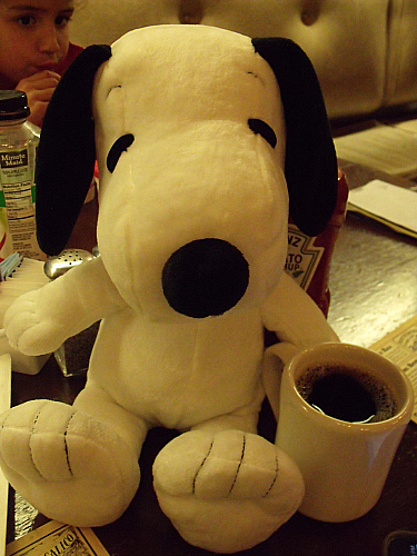 Snoopy enjoying a cup of coffee at Ghost Town Grill