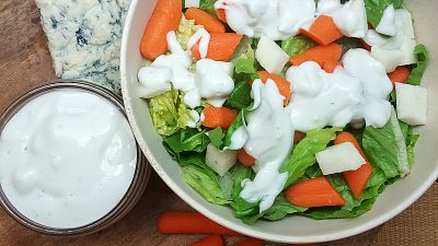 bowl of salad with homemade blue cheese dressing