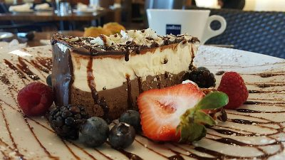 mousse cake dessert triple chocolate berries