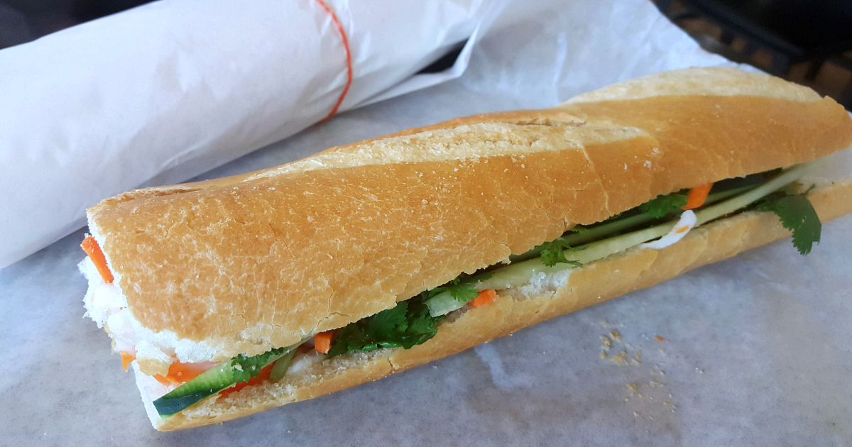 banh mi sandwiches wrapped in white paper