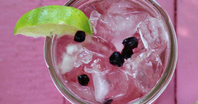 close up overhead view blueberry lime soda in mason jar