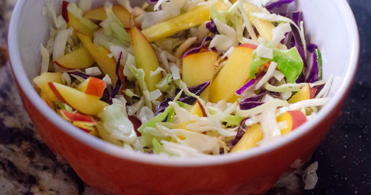 fruit slaw in mixing bowl