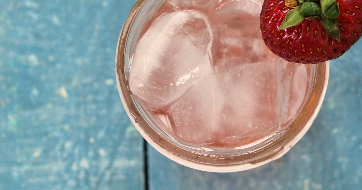 overhead close up strawberry soda mason jar