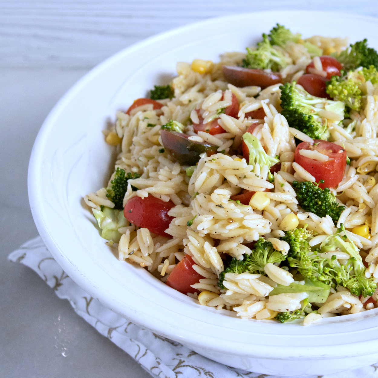 orzo pasta salad in white bowl