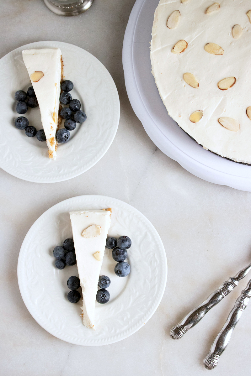 no text pin overhead view of blueberry almond cheesecake
