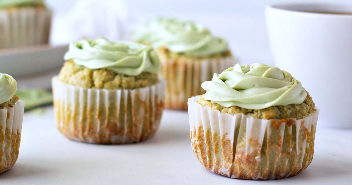 several matcha green tea cupcakes and coffee