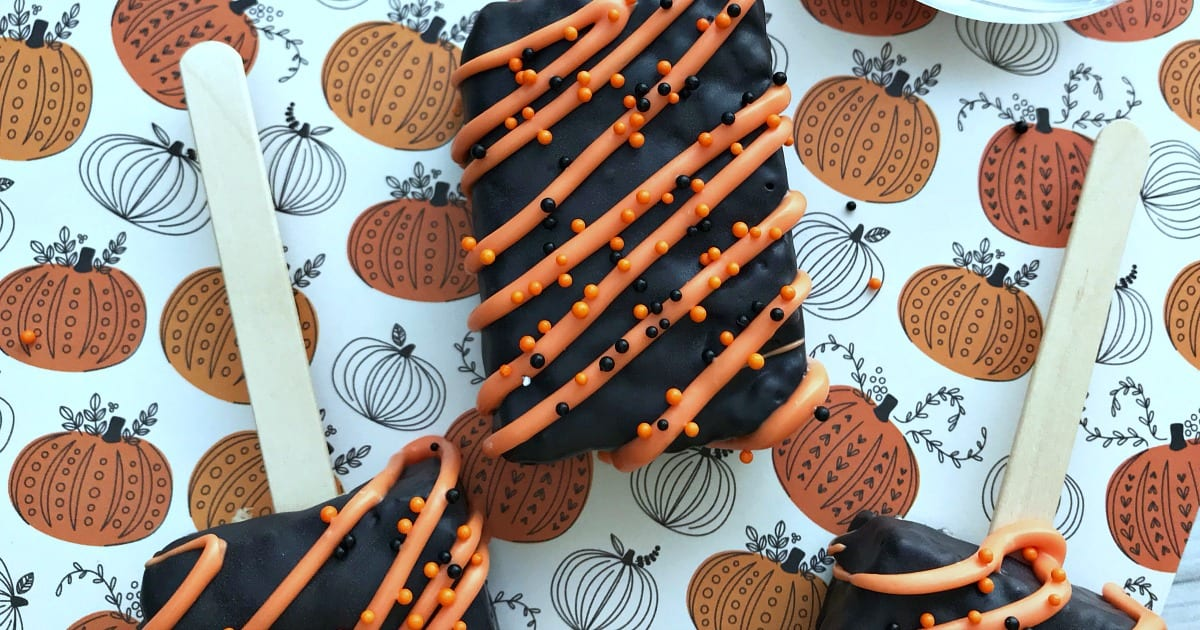 chocolate covered halloween krispie pops