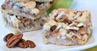 close up caramel apple cookie bars and pecans