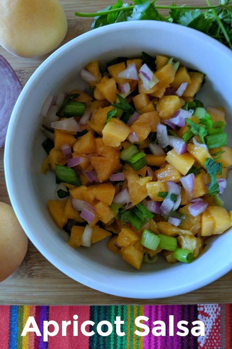 pin fresh apricot salsa in white bowl
