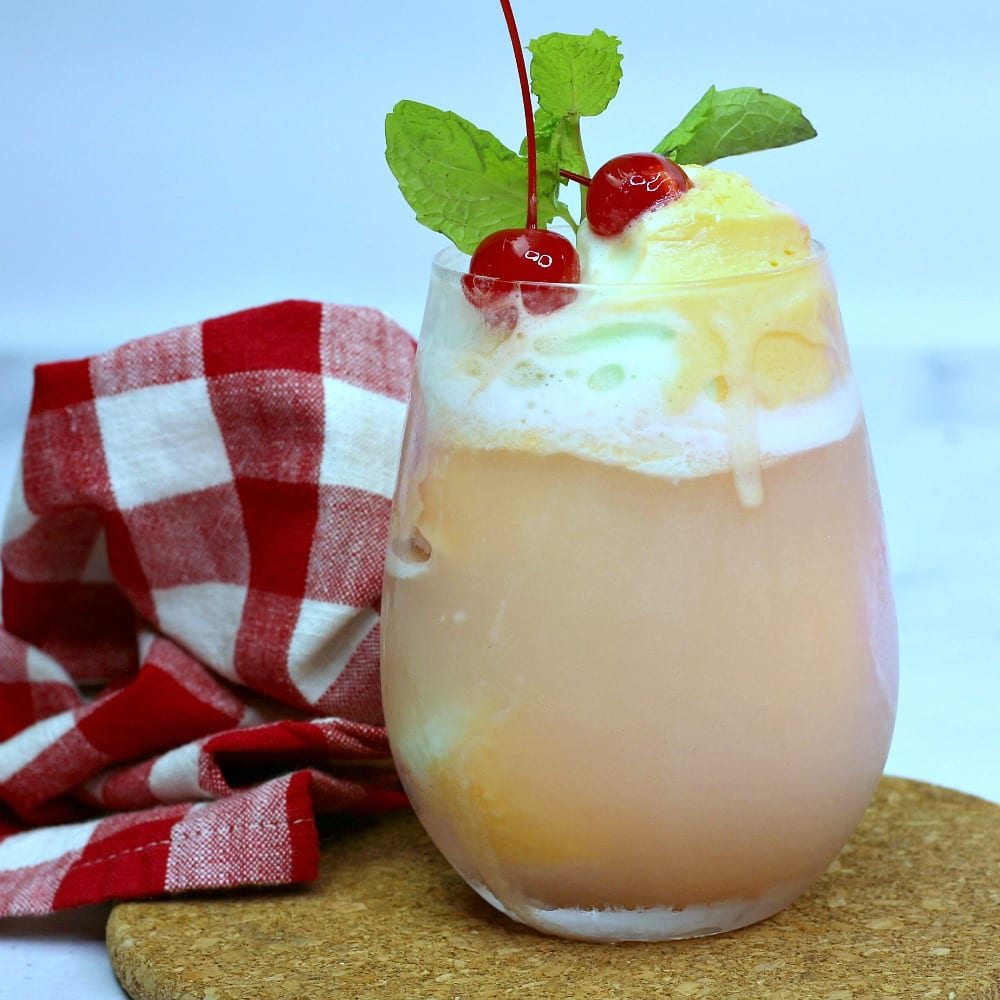 insta square image of boozy sherbet float with gingham napkin