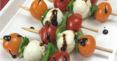 close up traditional caprese kebab with balsamic glaze