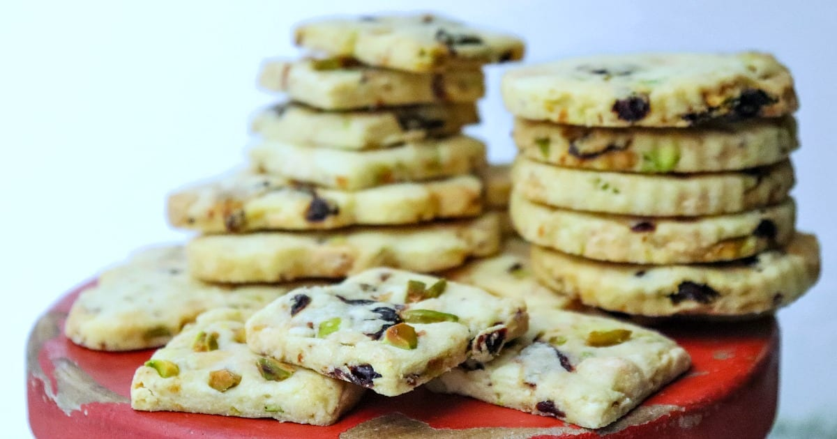 piles of pistachio cookies