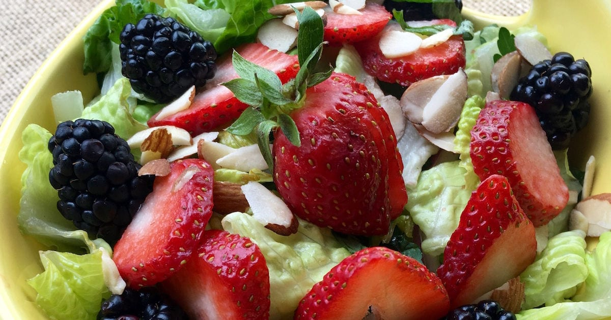 feature berry salad with homemade raspberry vinaigrette