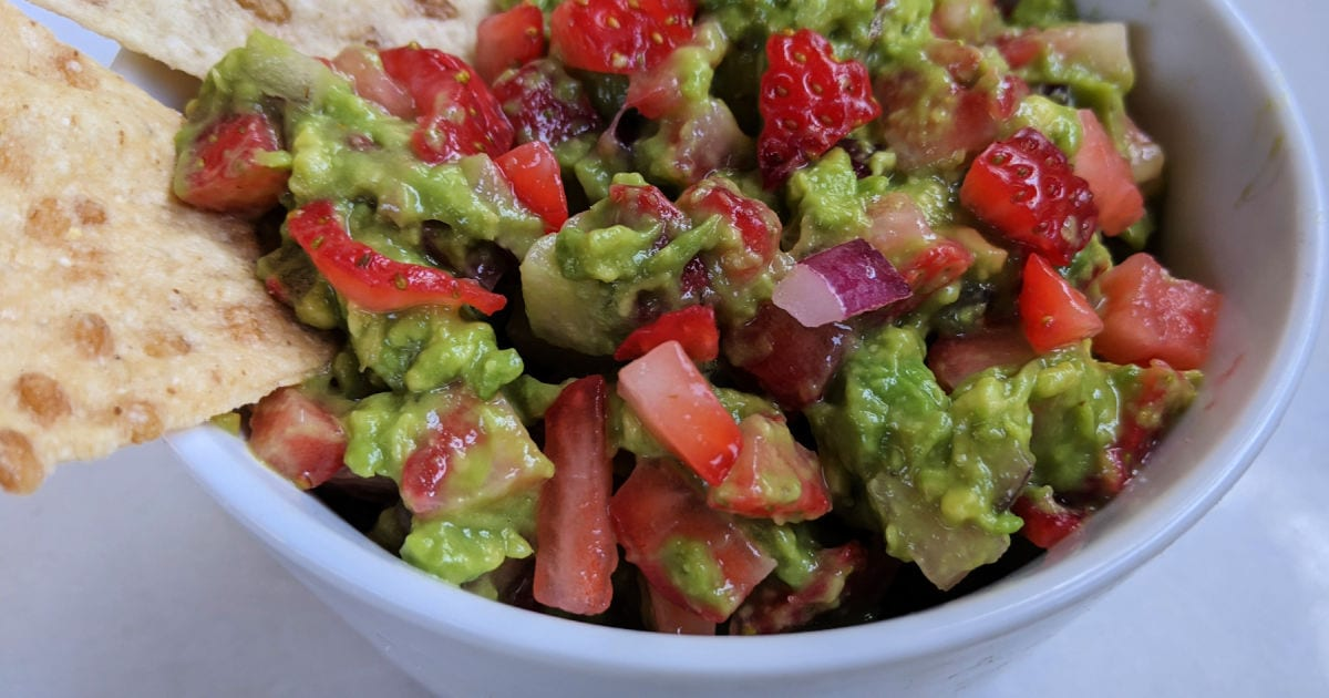 white bowl of strawberry guacamole