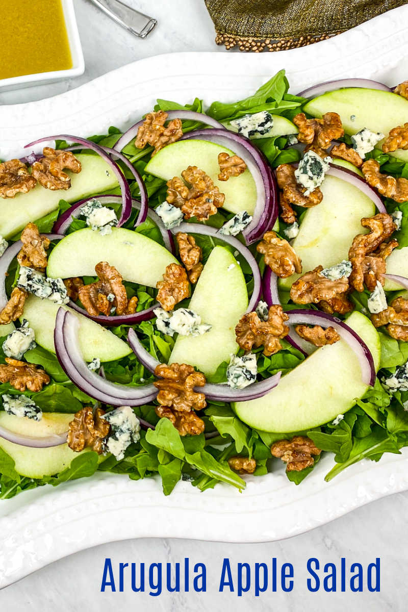 This arugula apple salad has blue cheese and honey roasted walnuts mixed in, so you will love each flavorful bite.