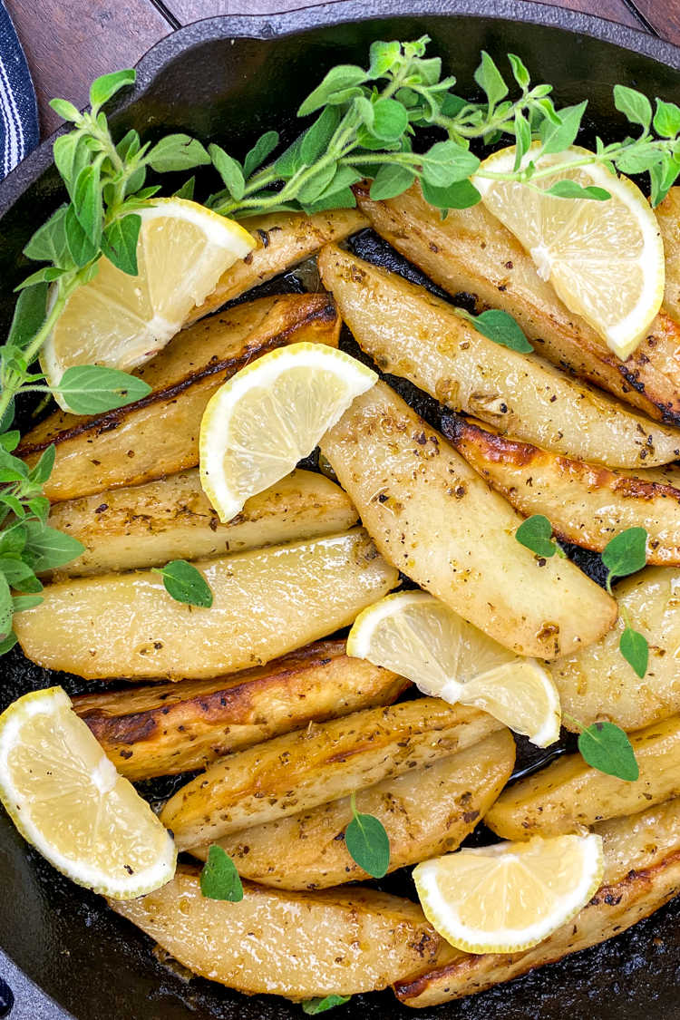Enjoy these lemon cast iron skillet Greek potatoes, when you want a budget friendly dish that has traditional Mediterranean flavors.