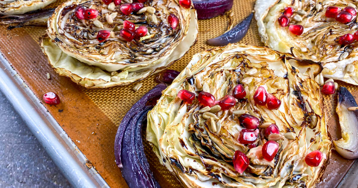 roasted balsamic cabbage steaks on baking sheet.