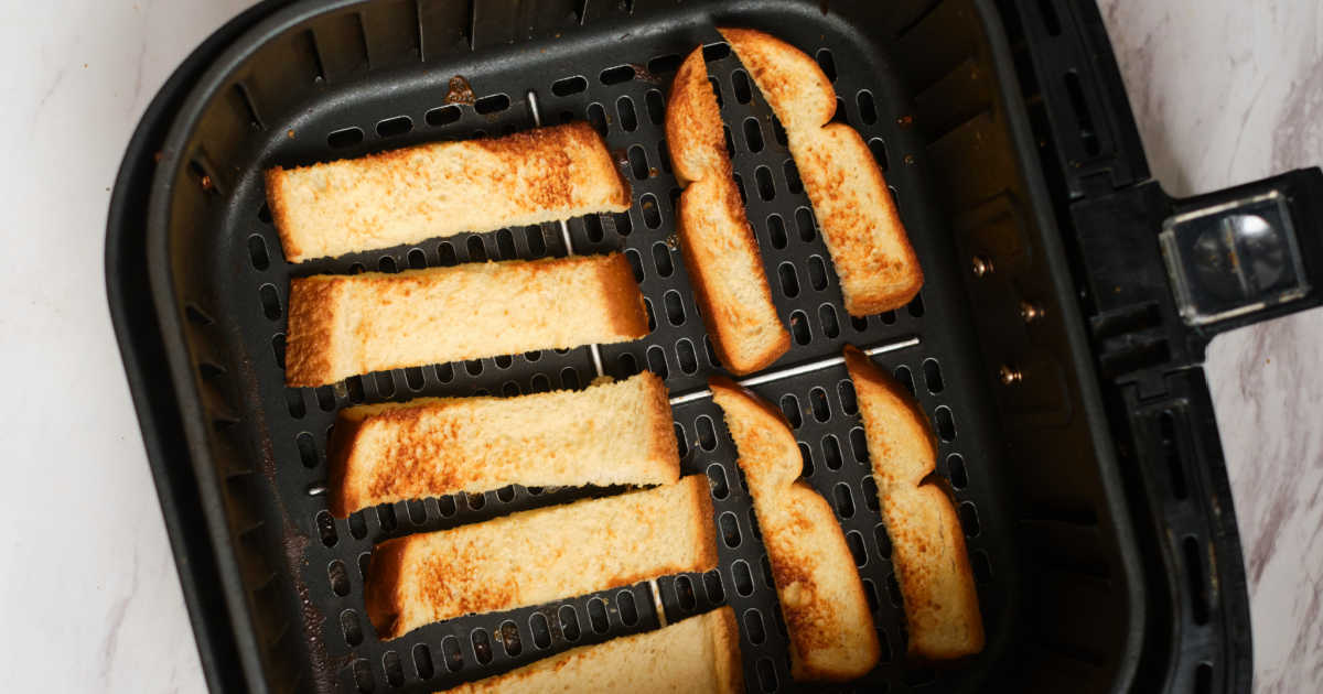 French toast sticks in Air Fryer tray.