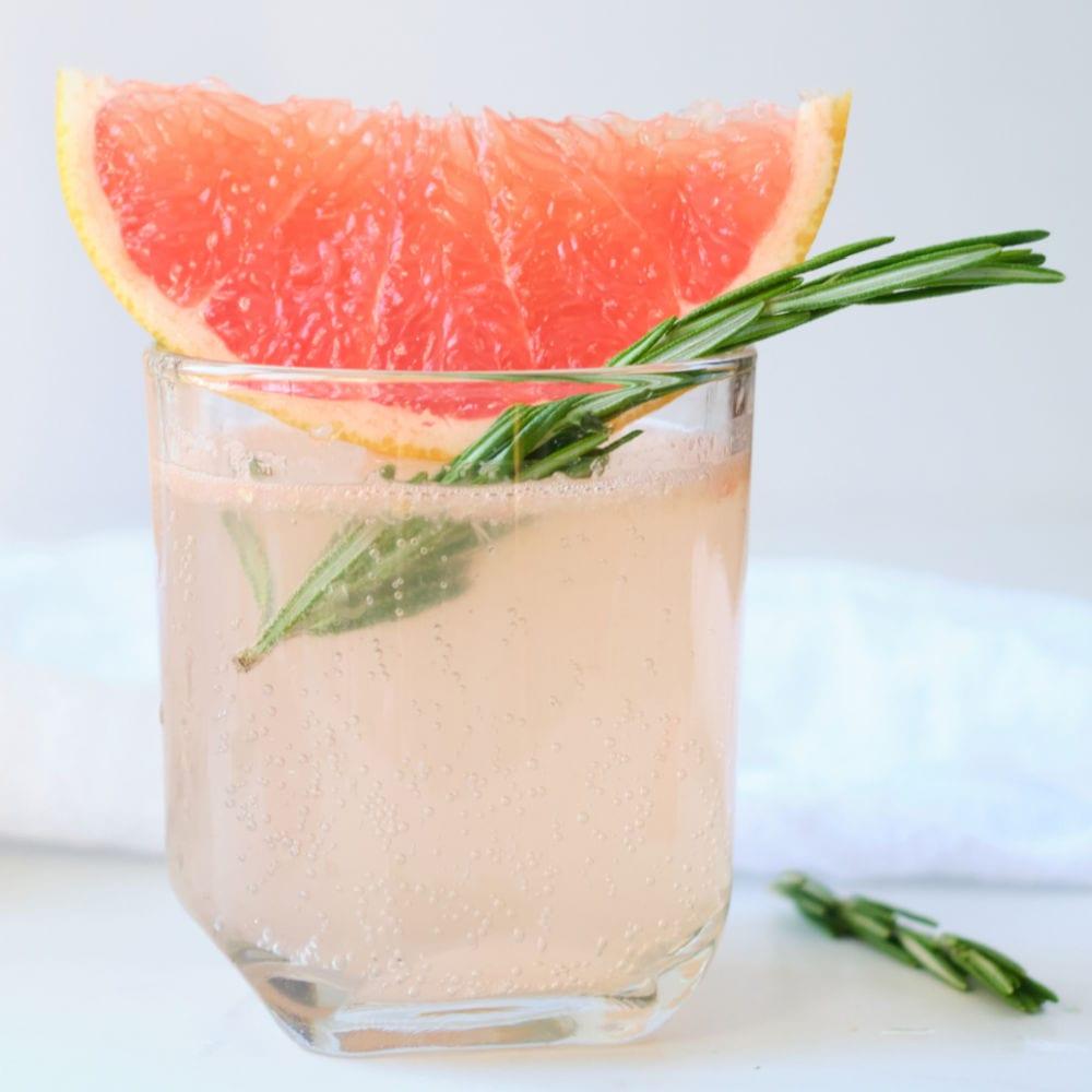 glass of sparkling pink grapefruit juice.