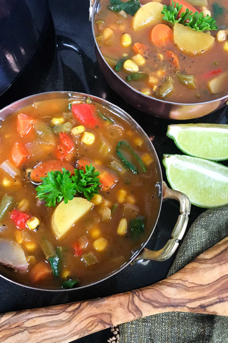 Nourishing fresh vegetables are the star of this slow cooker veggie soup, so the vegan dish is a tasty comfort food lunch or dinner.