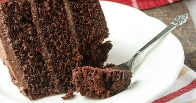 3 layer chocolate cake with fork.
