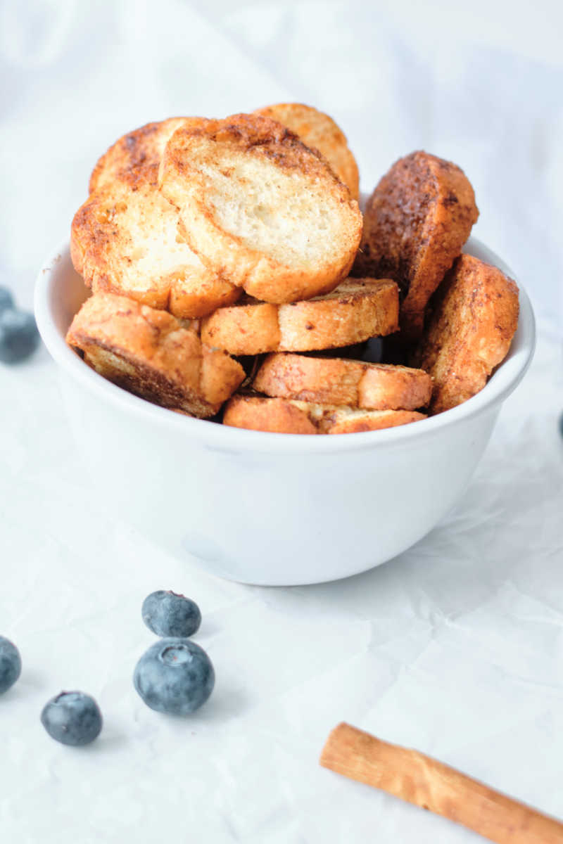 When you have leftover bread, you can easily make delicious cinnamon sugar air fryer baguette crisps for a treat.
