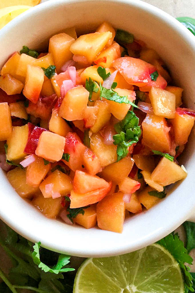 Add a burst of fresh fruit flavor to your snacks and meals, when you make this beautiful and delicious jalapeno peach salsa.