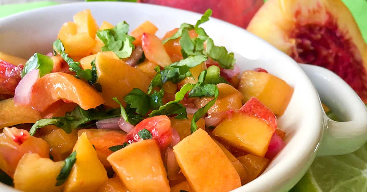 peach salsa in white bowl.