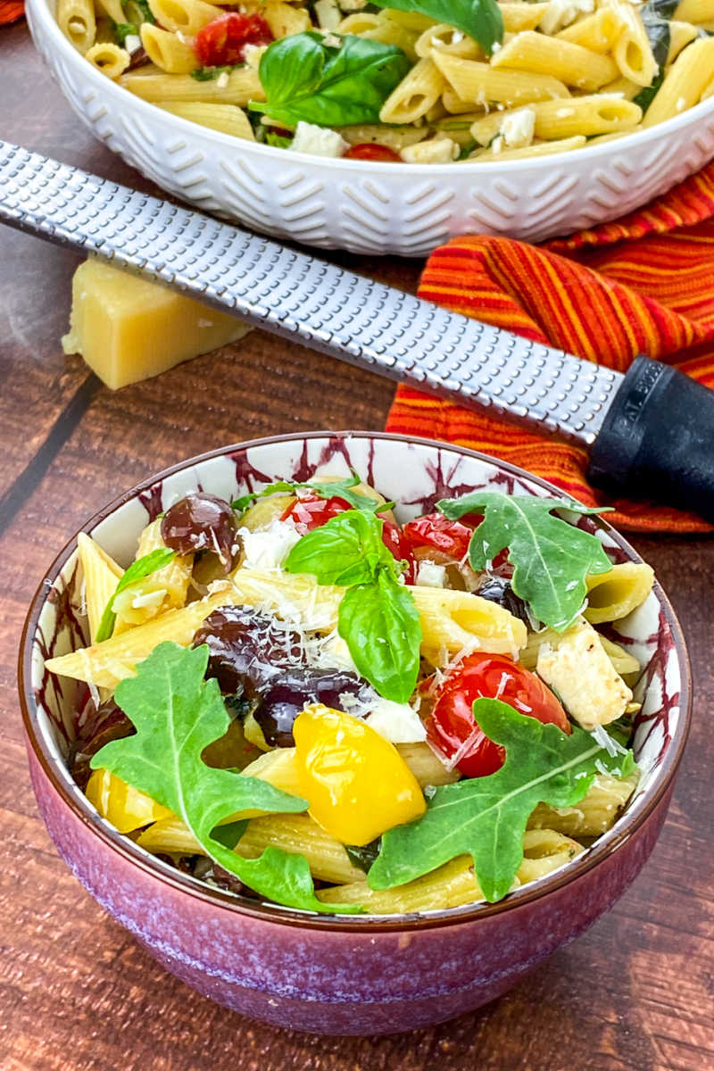 A Greek pasta salad with feta cheese is the perfect side dish, especially when it has a tangy lemon dressing and fresh ingredients.