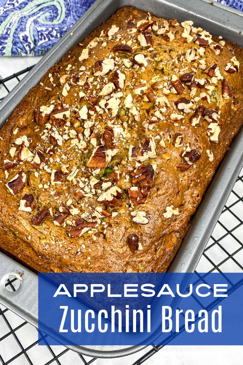 This delicious applesauce zucchini bread has pecans mixed in and on top, so you will want to bake and eat it often.