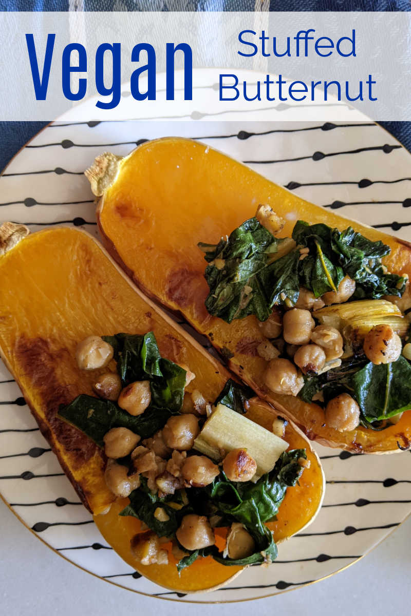 This vegan stuffed butternut squash is roasted is filled with a flavorful mix of chard and chickpeas, so it is delicious.